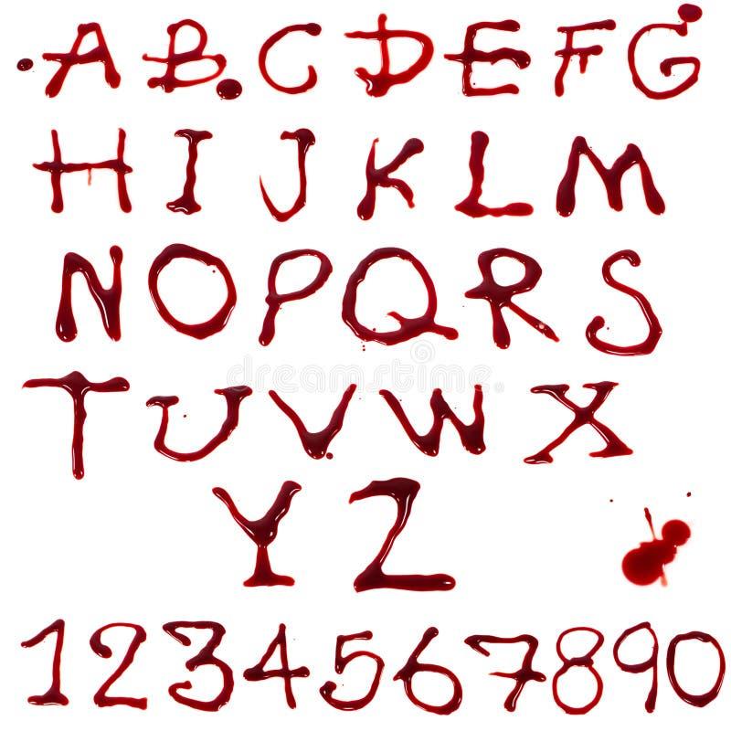 Letras que gotejam com sangue imagens de stock
