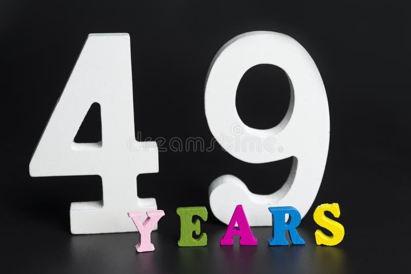 Letras y números-cuarenta-nueve en un fondo negro fotografía de archivo libre de regalías