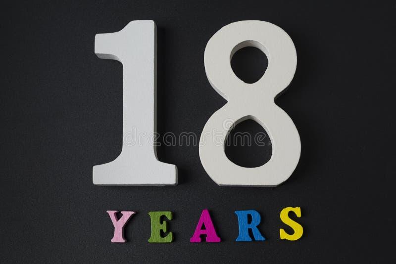 Letras y números por dieciocho años en un fondo negro fotografía de archivo libre de regalías