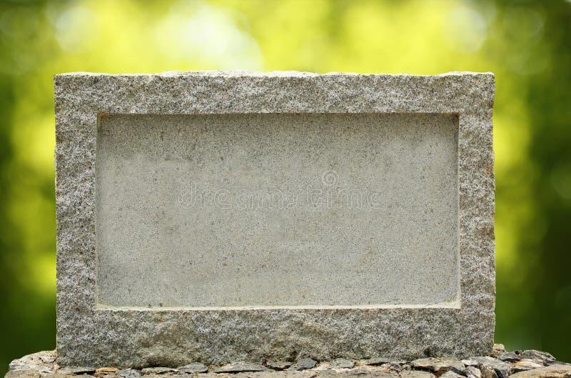 Letrero vacío del granito con la frontera y el marco fotos de archivo