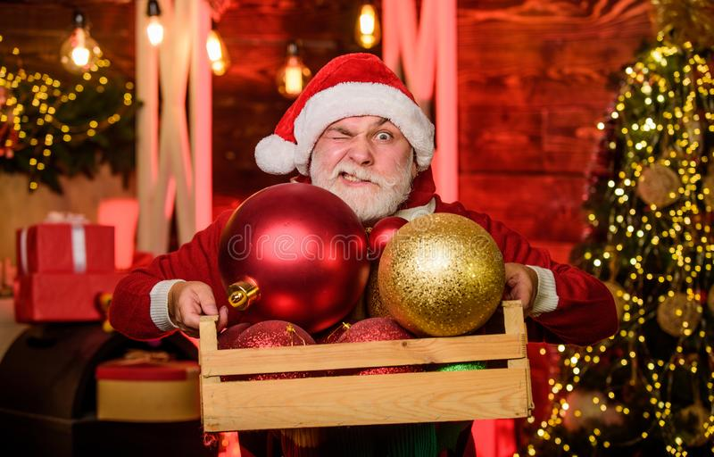 Lets celebrate. happy santa with beard. mature bearded elf. man decorative ball. Gift shopping. christmas decoration. Decorate your xmas. Time for presents stock photo