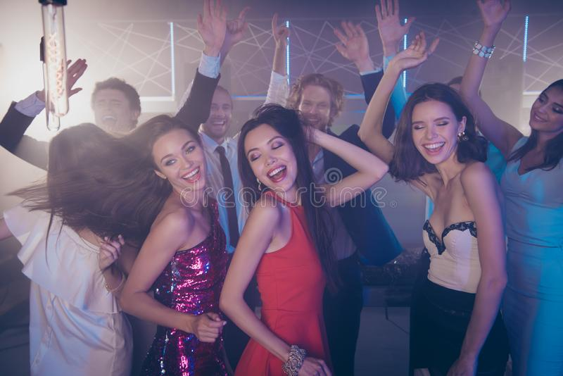 Lets dance all night Cheerful crowd with handsome man and lovel royalty free stock photos