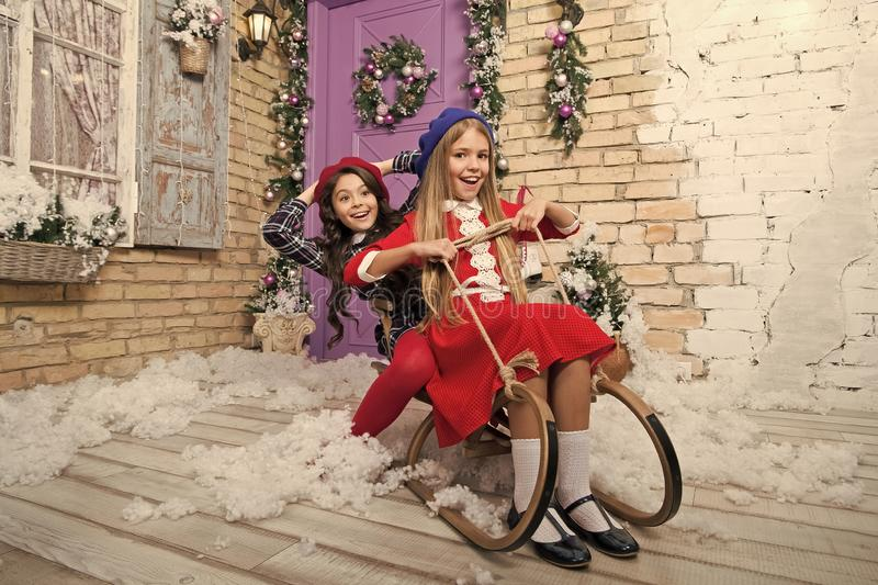 Lets do this. xmas online shopping. Family holiday. Happy new year. Winter. The morning before Xmas. Little girls on. Sledge. Christmas tree and presents. Child stock photography