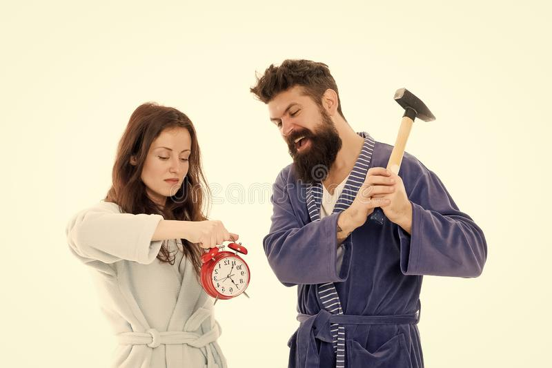 Lets get rid of this annoying alarm clock. Couple in bathrobes going to destroy alarm clock and stay at home. Breaking. Rules. Tired of early awakening. Man stock images