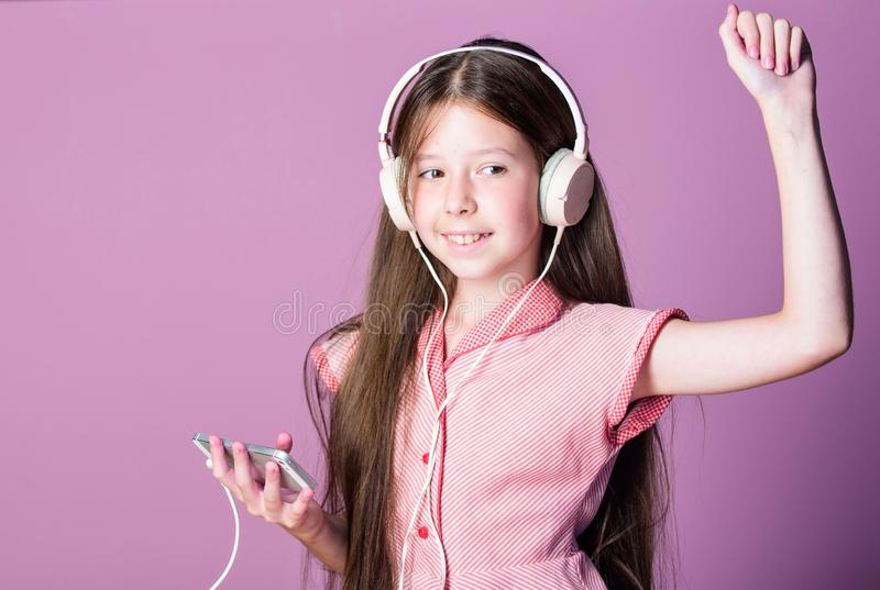 Lets go dance. self education. Mp3 player. girl listen to music. Audio book. back to school. small girl pupil in. Headphones. child study online. E learning stock photos