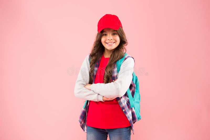 Lets go travel. Happy little hipster wear backpack and baseball cap. Cute small hipster smiling with fashionable look stock photo