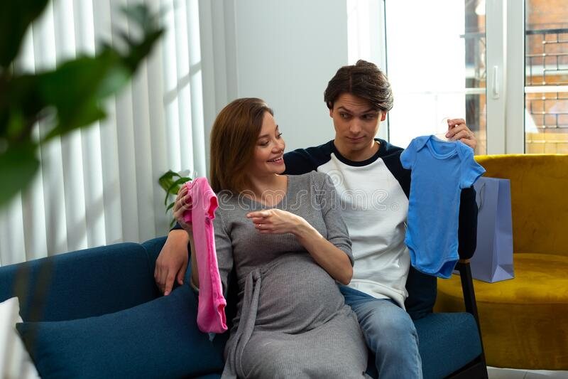 Lets guess if it is baby boy of girl in the belly royalty free stock images