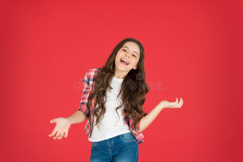 Lets have fun. Come on. Carefree and joyful. Kid girl carefree expression. I do not know. Take it easy. Child with long stock photo