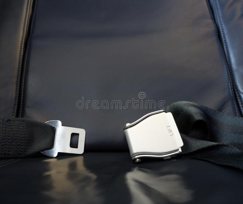 Lets the journey begin! Airplane leather seat with metal fasten royalty free stock image