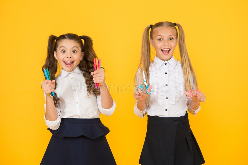 Lets make something awesome. Girls creative children. Crafts for elementary school kids. Schoolgirls hold school. Supplies crafts. Creative crafts. Activity royalty free stock photos