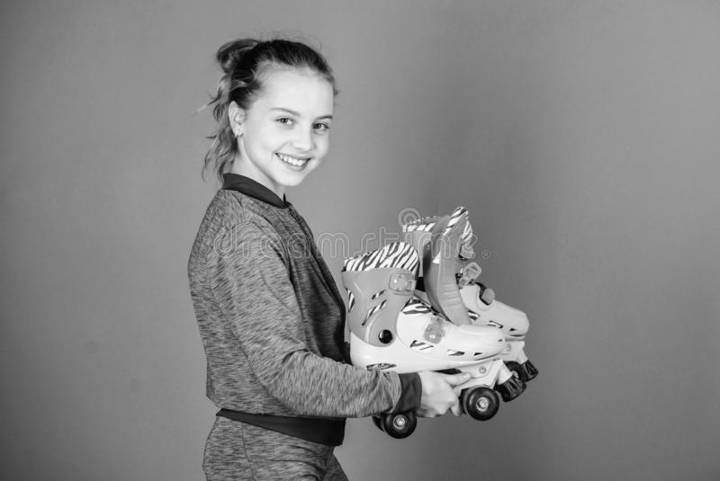 Lets ride. Girl cute little child hold roller skates. Hobby and active leisure. Happy childhood. Pick proper roller. Skates size. Why kids love roller skates royalty free stock photo