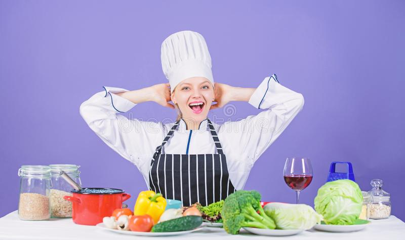Lets start cooking. Woman chef cooking healthy food. Gourmet main dish recipes. Girl in hat and apron. Delicious recipe. Concept. Cooking healthy food. Fresh royalty free stock photo