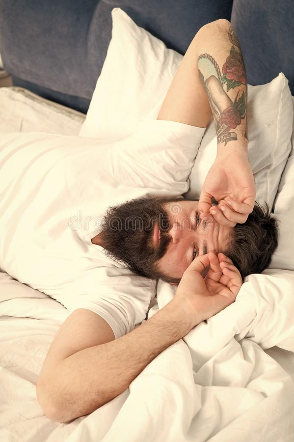 Lets start new day. Relax and sleep concept. Man bearded guy sleep on white sheets. Healthy sleep and wellbeing. Man. Bearded hipster sleepy in bed. Early stock image
