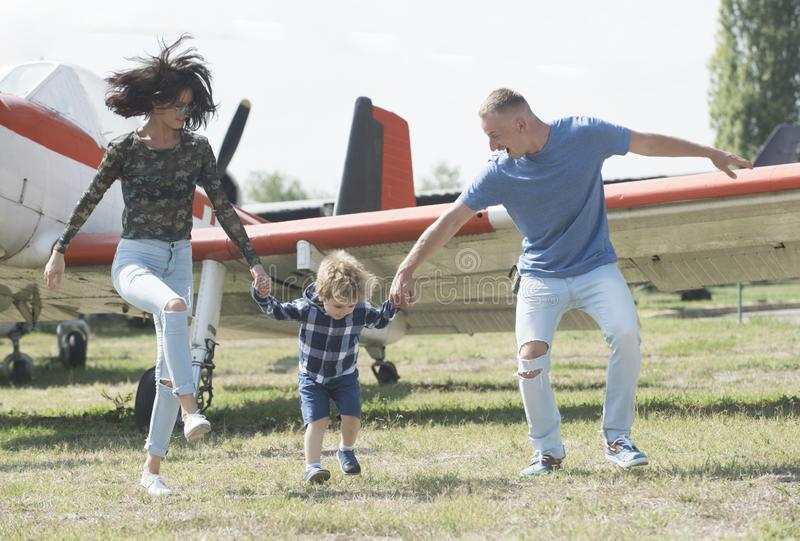 Lets start our journey. Travelling by air. Family on vacation trip. Couple with boy child at plane. Aircraft tour and royalty free stock image