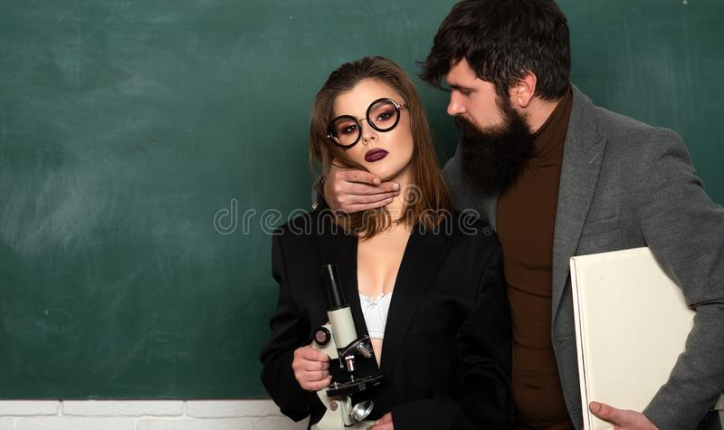 Lets Talk Sex. Couple of man and woman in classroom. Library romance. Office romance. Lesson and sex education in high royalty free stock images