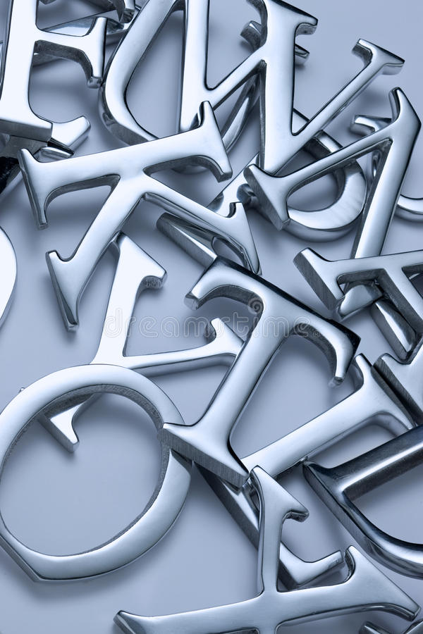 Letter Background. An abstract background made of metal letters and a neutral tone