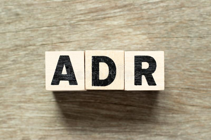 Alphabet letter block in word ADR Abbreviation of adverse drug reaction on wood background. Letter block in word ADR Abbreviation of adverse drug reaction on royalty free stock images