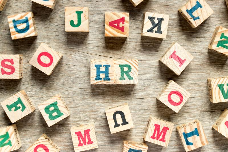 Letter block in word HR & x28;Abbreviation of human resource& x29; with another on wood background. Resources, concept, people, business, team, management stock photo