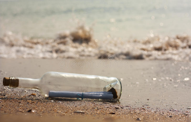 Letter in a bottle. A letter in a bottle on the beach royalty free stock images