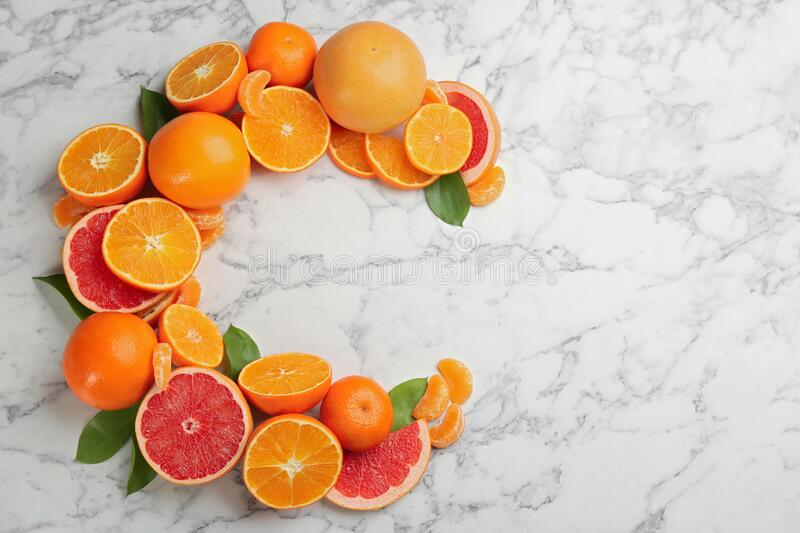 Letter C Made With Citrus Fruits On Table As Vitamin