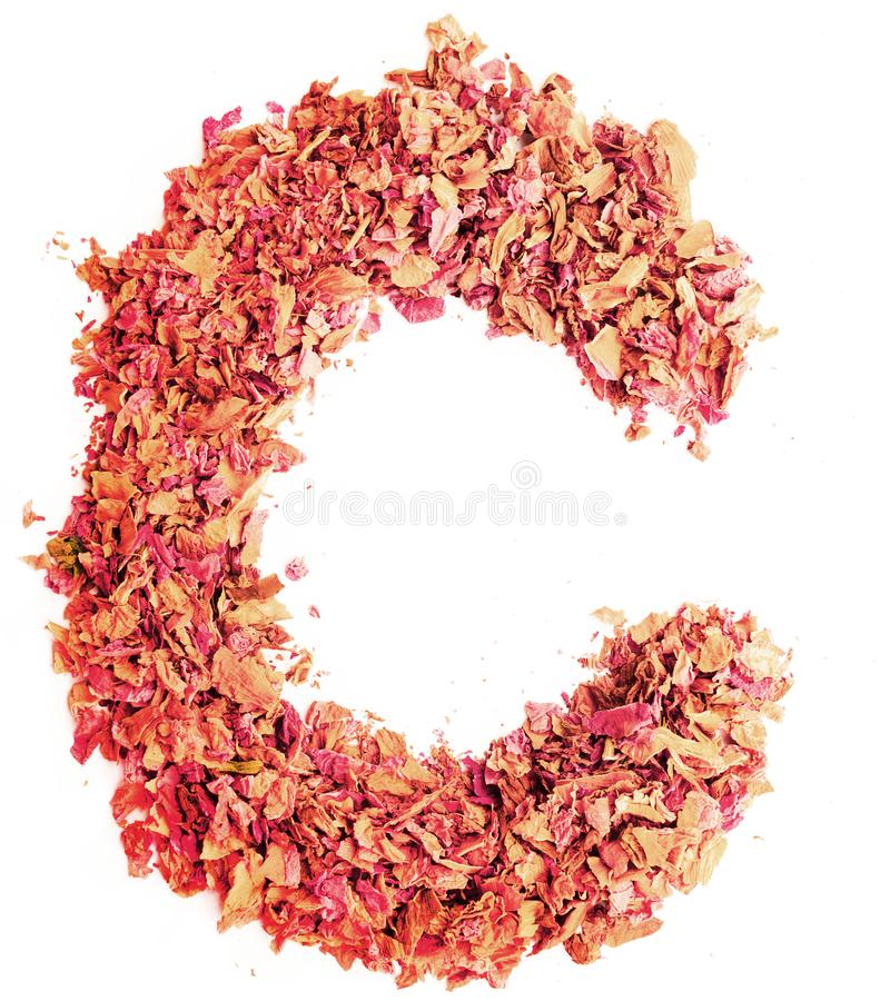 Letter C made of dried rose petals, isolated on white background. Food typography, english alphabet. Design element. stock photos