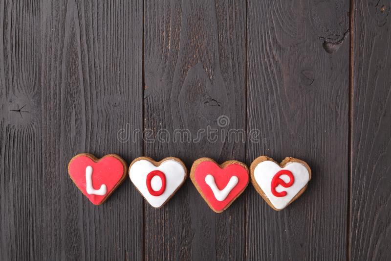 Letter cookies for Valentine`s day or wedding day. On old wooden table stock photo