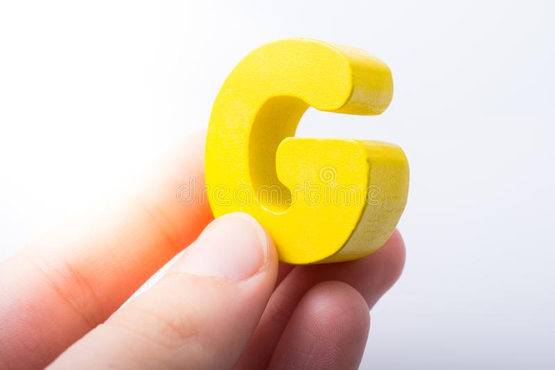 Letter cube G of made of wood. Letter cube of G of  Alphabet made of wood stock photos