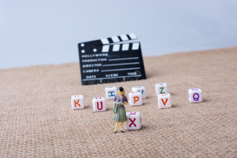 Letter cubes beside a director clapper board. Colorful letter cubes beside a director clapper board stock photos