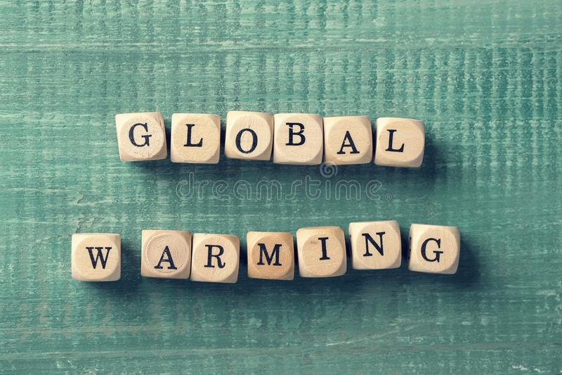 Letter cubes with word global warming. Environment concept royalty free stock photography