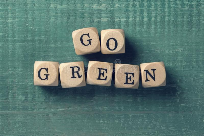 Letter cubes with word go green. Environment concept royalty free stock photo