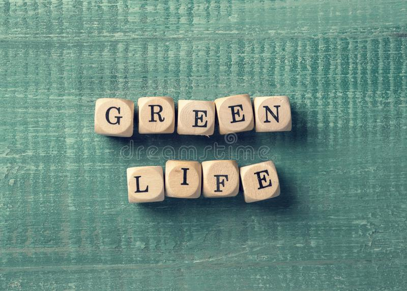 Letter cubes with word green life. Environment concept stock images