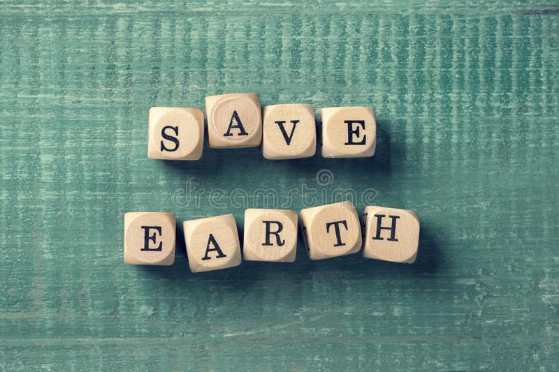 Letter cubes with word save earth. Environment concept royalty free stock images