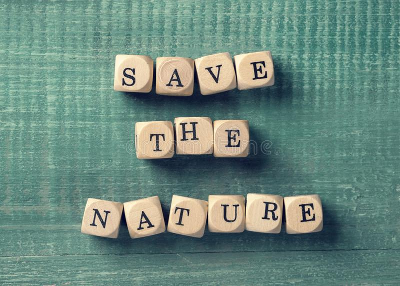Letter cubes with word save the nature. Environment concept stock image