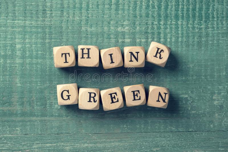 Letter cubes with word think green. Environment concept stock photography