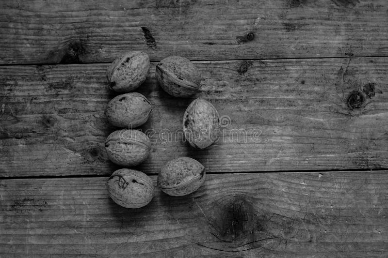 Letter D from walnuts. Top view of english alphabet made from walnuts on a wooden table. Letter D stock photos