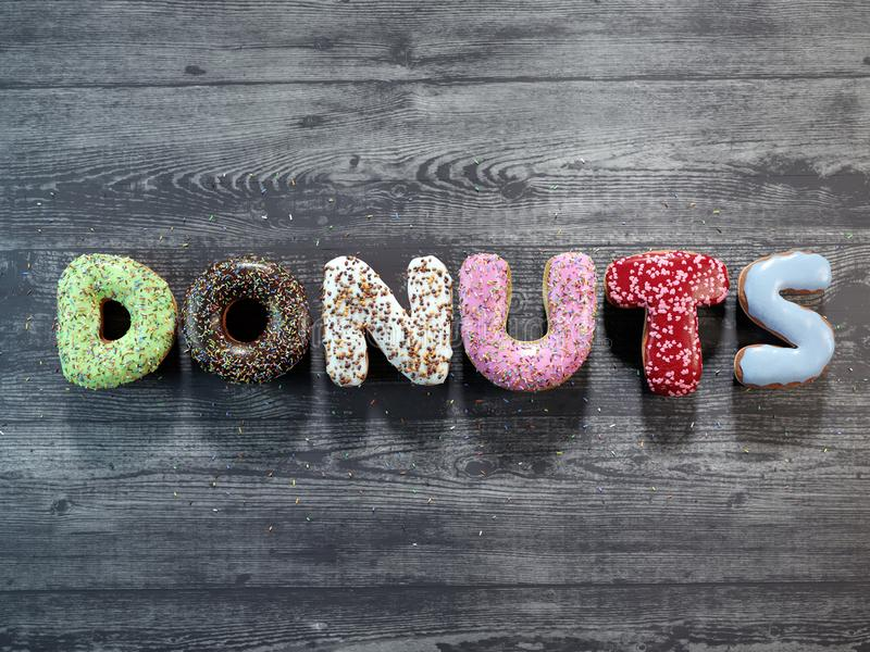 Letter donuts with different icing royalty free stock photography