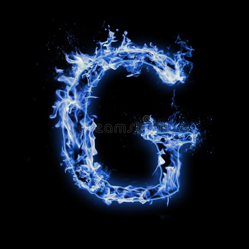 Letter G. Blue fire flames on black stock photography