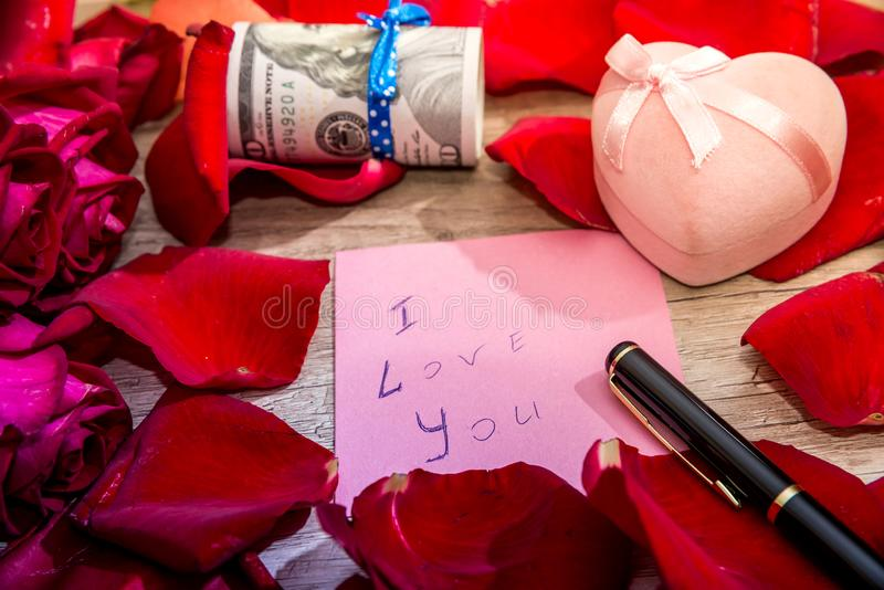 Letter with I love you note, red rose and pen. stock photo