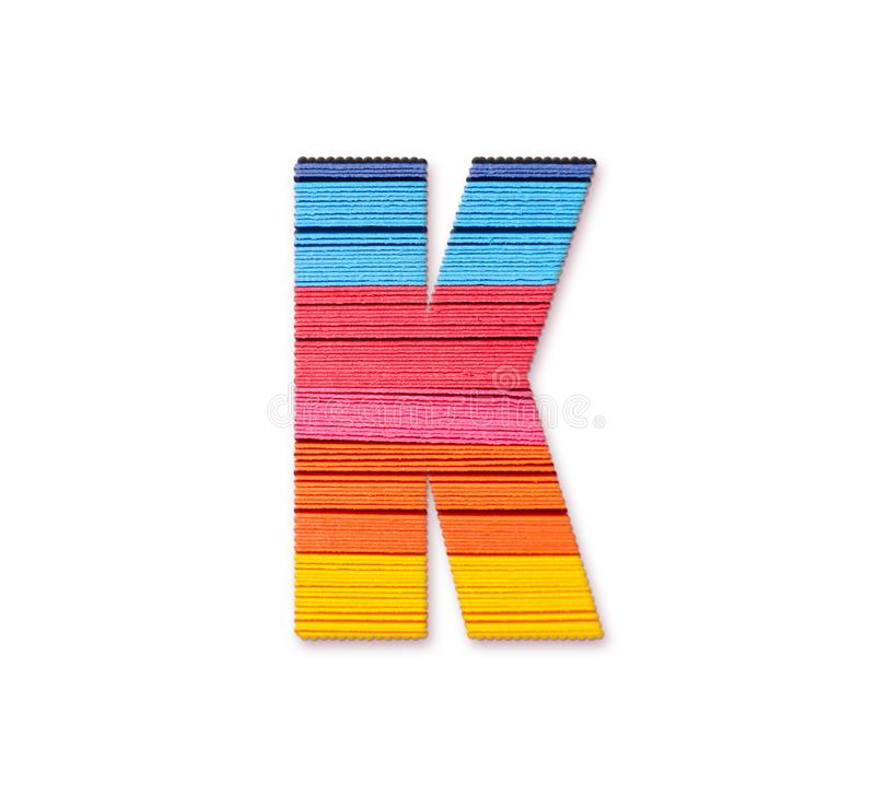 Letter K. Rainbow color paper. royalty free stock photo