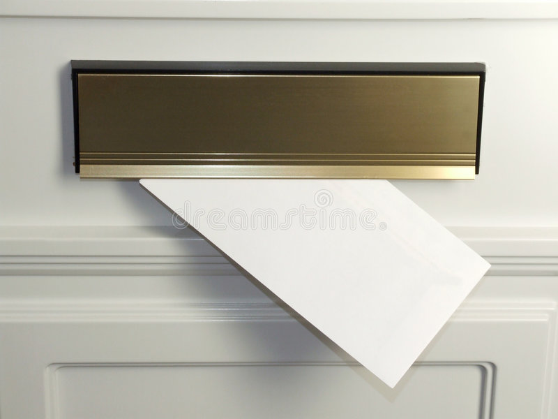 Letter in the mailbox. A letter hangs out of a post box, with a blank envelope for designers use royalty free stock photos