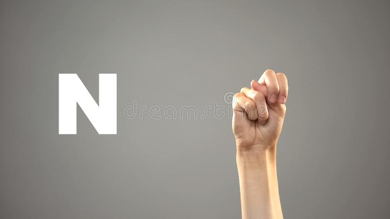 Letter N in sign language, hand on background, communication for deaf, lesson royalty free stock photography
