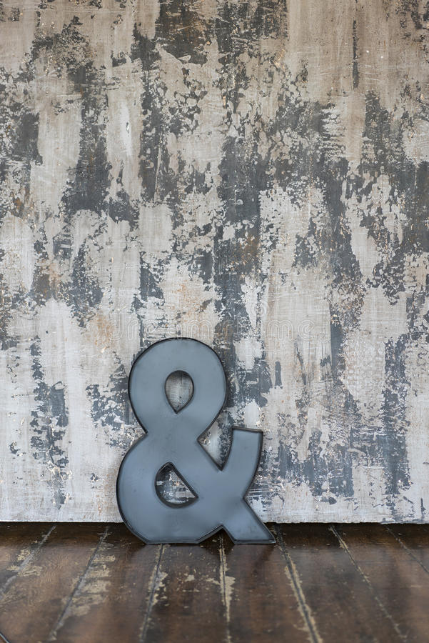 A letter over a textured wall in a vintage Location stock photos