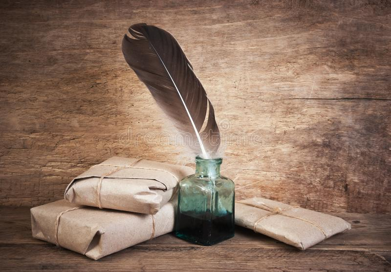 Letter. And a quill in the inkwell royalty free stock photo