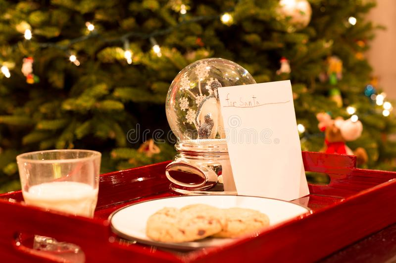 Letter for Santa with cookies and glass of milk royalty free stock image