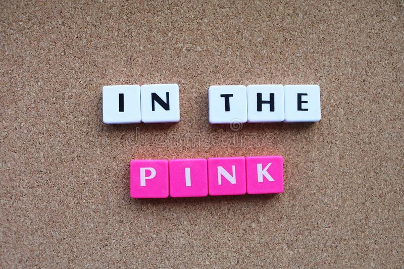 Letter tiles spelling in the pink in good health royalty free stock photo
