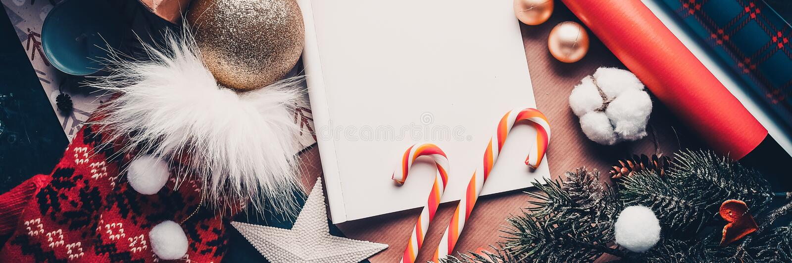 A letter to Santa Claus, Christmas decorations and caramel. top view. Banner stock photos