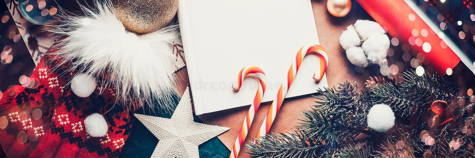 A letter to Santa Claus, Christmas gifts. Christmas fir tree, decorations on a dark background. Banner stock photo