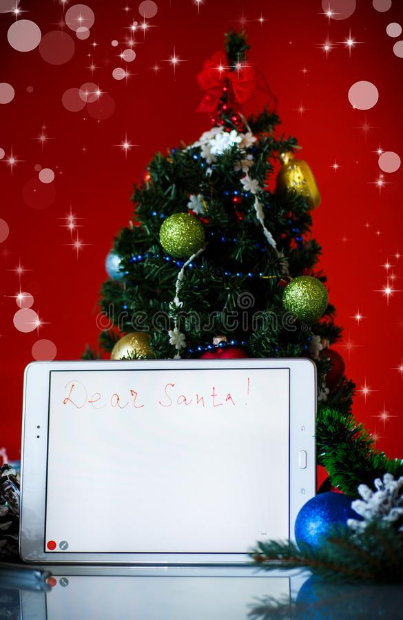 Letter to Santa Claus on a tablet stock photo