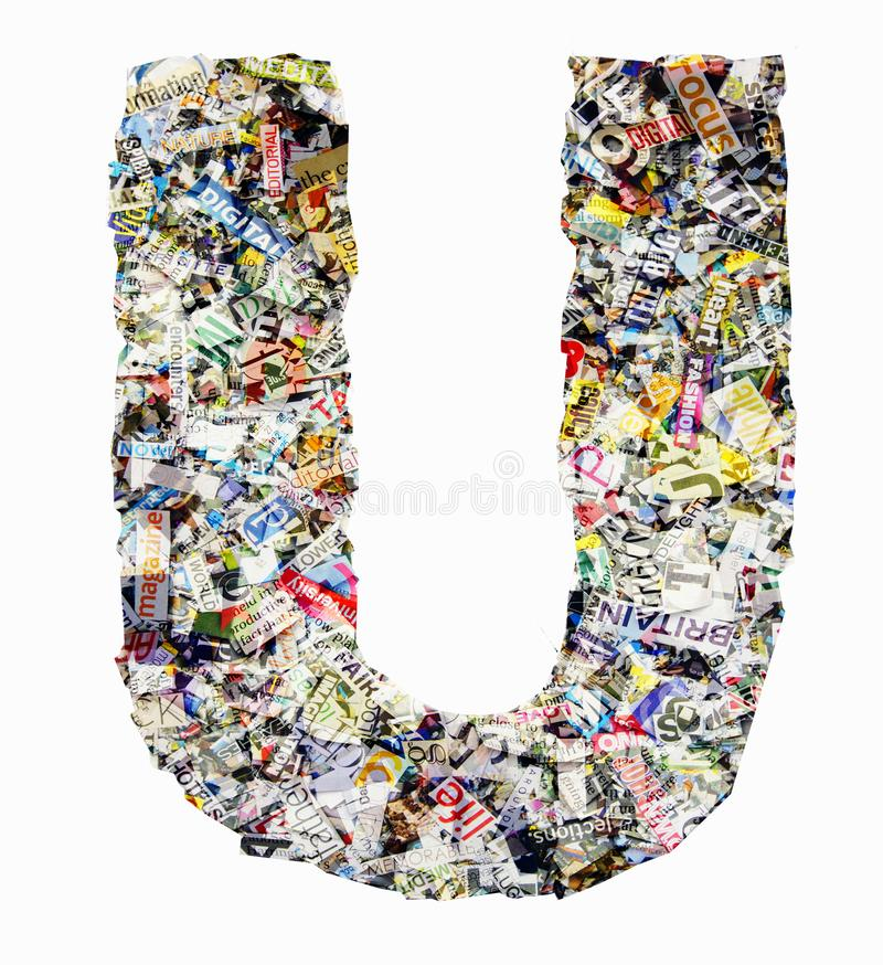 The letter U made from newspaper and magazine isolated stock photography