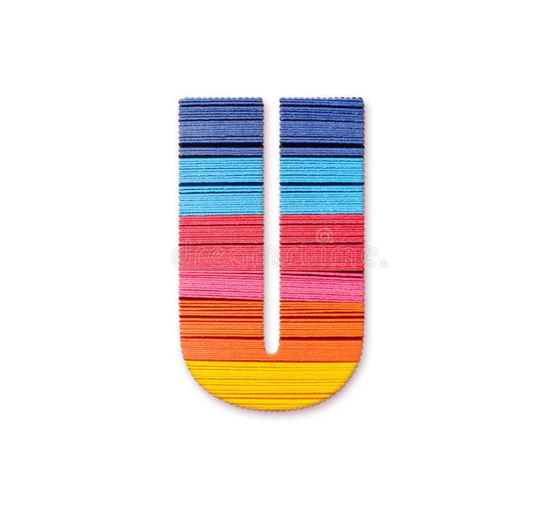 Letter U. Rainbow color paper. stock images